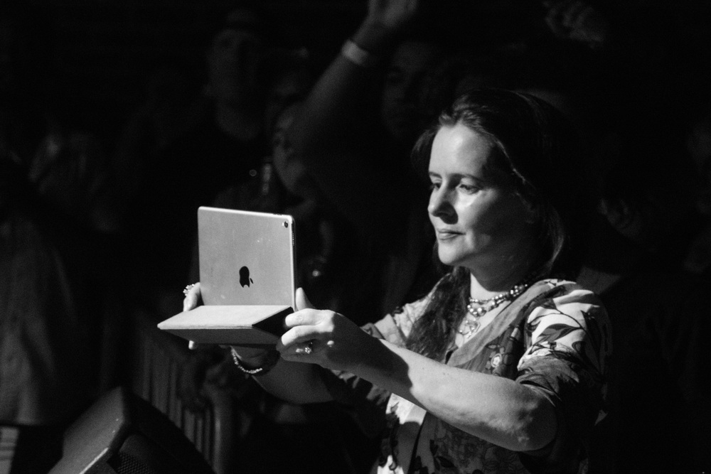 She held this iPad up for the entirety of the show