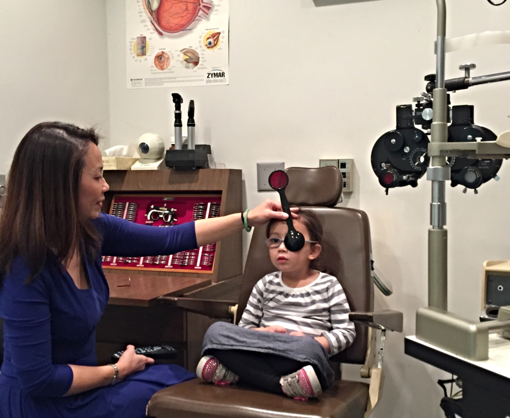 Dr. Nguyen testing child's distance acuity