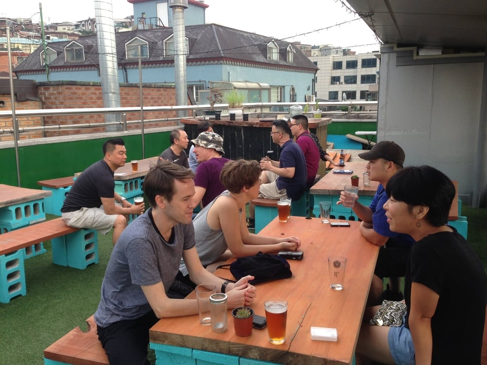 Real estate investors talking real estate on Southside Parlour's rooftop