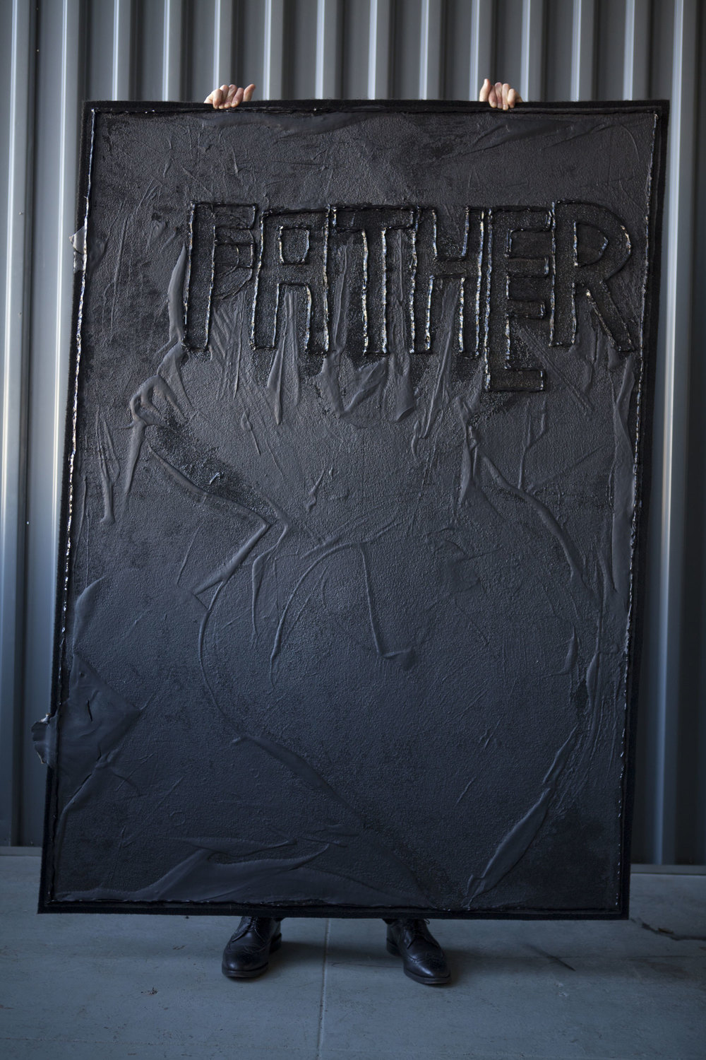 Father, 2013 *Carried by Raphael Sigal   American coal tar and black silicon on black carpet  MANA studio, NJ  Photographer: Amina Hasen