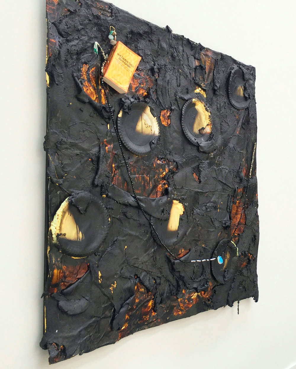 The City of Gold and Lepers, 3 lions in the desert 2016 | 170 X 164 CM Gesso, packaging laminated gold paper, laminated cardboard gold plate, Elastic Bitumen Mastic, speak black glass, synthetic sea sponge, stainless steel cable, Book. At Circle of Life ( Curated by: Carmit Blumensohn ), NordArt 2016, Büdelsdorf, Germany