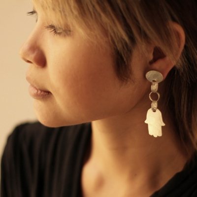 Matte silver earrings with hamsa drop $220.00