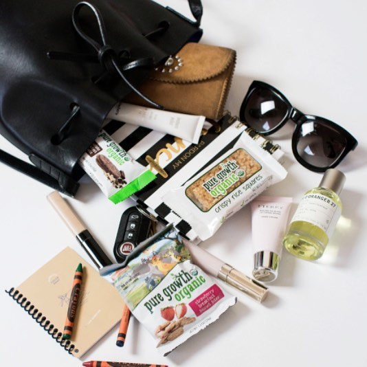 The contents of your bag are a little slice of your life. We want to see what you pack to be ready for anything!  Share your purse, backpack or travel bag pics with #PGOOnTheGo. This peak inside is brought to you by cool mom @lauralbouy who has everything to cure a hungry kiddo or hop to a lunch meeting. #MomLife