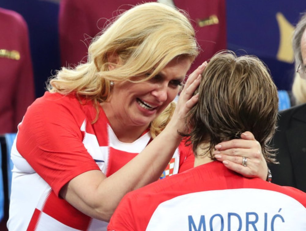 Croatian President Kolinda Grabar-Kitarovic comforts player Luka Modric after Croatia's World Cup Final loss to France.