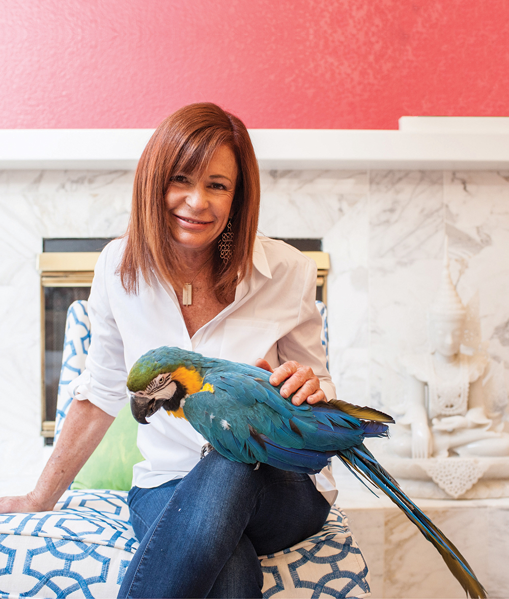 Michele Raffin with a blue and gold macaw