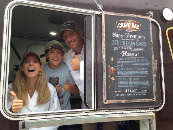 Kim and Scott Holstein in their Crave Bar food truck. Photo courtesy of The Crave Bar.