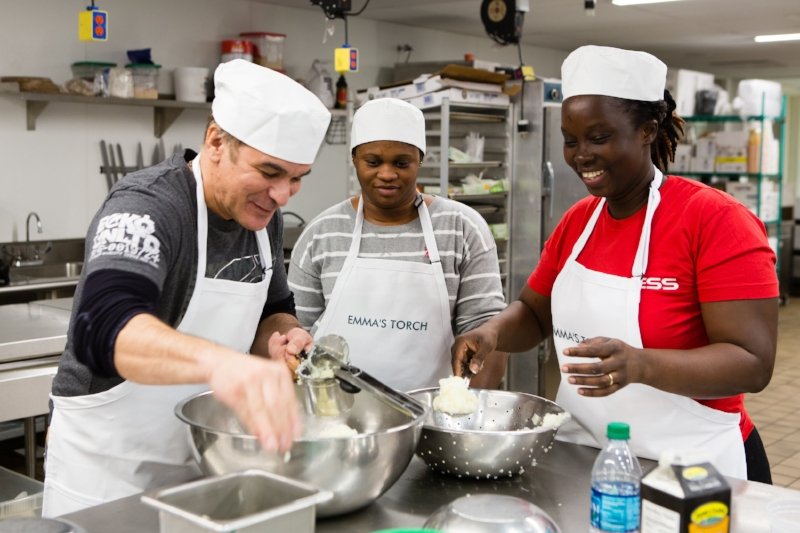 Three Emma's Torch students have fun in the kitchen.
