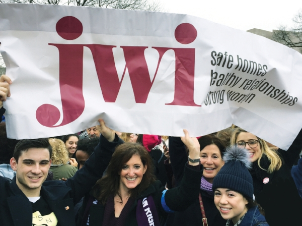 At the Women's March in Washington, D.C. in January, 2017: JWI VP of Communications Meredith Jacobs with her son, Jules (left), and CEO Lori Weinstein with her daughters, Emma and Chloe (right).