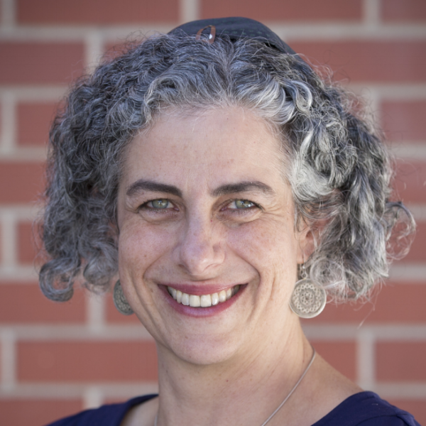 """Dr. Caryn Aviv - Dr. Caryn Aviv (rabbinic candidate and associate director) has had one foot in academia and one foot in Jewish entrepreneurship for over 15 years. After earning a Ph.D. in sociology and anthropology from Loyola University Chicago in 2002, she taught Jewish Studies and sociology at University of Colorado at Boulder and University of Denver. Caryn served as co-founder/director of research with Jewish Mosaic, and director of Storahtelling Colorado. Caryn has written three books, including Queer Jews, New Jews: The End of the Jewish Diaspora, and American Queer: Now and Then. An emerging rabbi, Caryn anticipates getting rabbinic smicha from ALEPH: The Alliance for Jewish Renewal in 2019.Caryn is excited to be leading the Open Tent B'nai Mitzvah program. She teaches the 2018/19 Year One Wednesday class (starting September 2018) and she is also available to mentor Year Two students. When asked what she loves about working with Open Tent B'nai Mitzah students, she shared, """"I love the deep conversations students and I share about the meaning of their lives. I love being a supportive presence and witness as students change and find their way through middle school. It's a privilege and honor to guide students as they stretch, challenge themselves, and grow into becoming Jewish teachers in their own right on the day of their ceremony."""""""