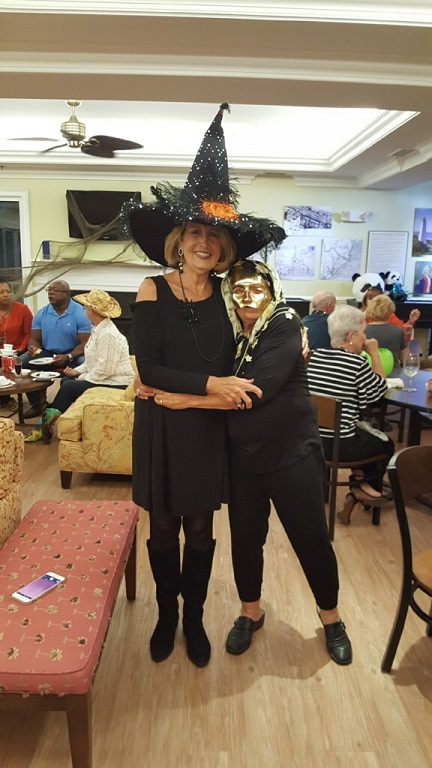 Miriam the tallest witch gives the golden girl a hug.