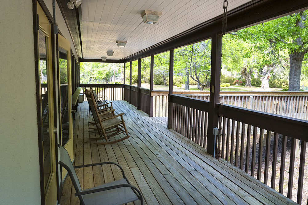 Open porch overlooking the live oak shady lawn and azaleas