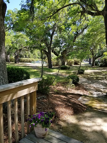 Imagine a grand entrance down the steps to your wedding guests and reception on the shady lawn.