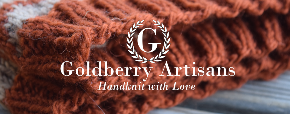 goldberry artisans initial logo orange cowl background.png