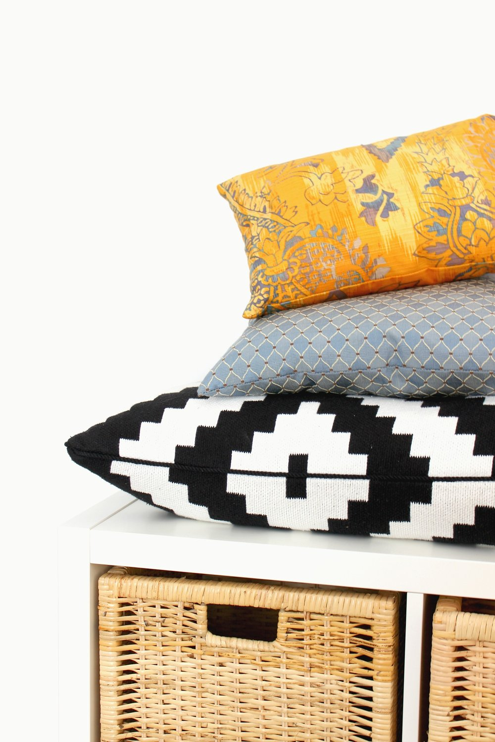 yellow-blue-black-and-white-tribal-cushions.jpg