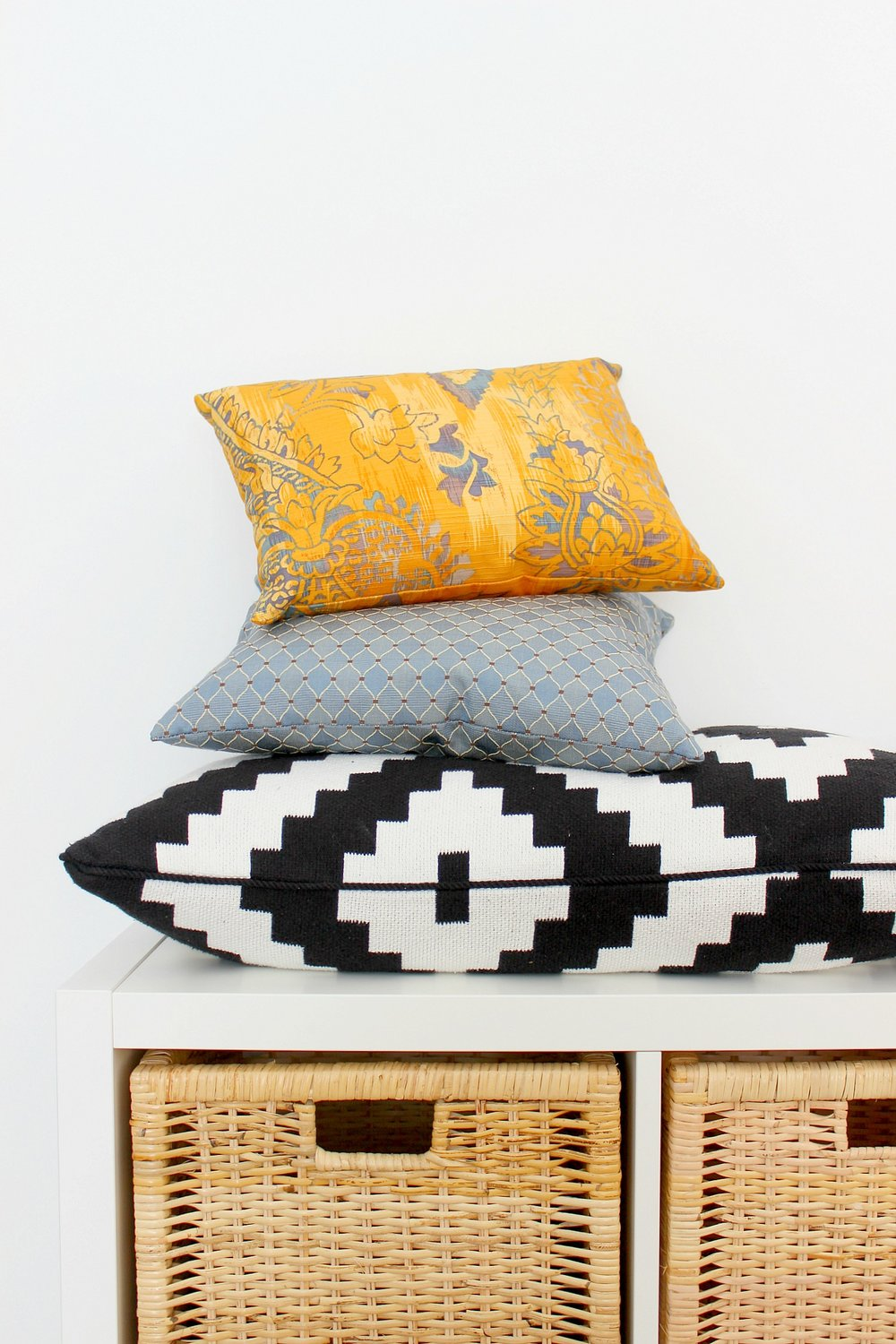 yellow-blue-black-and-white-tribal-cushions-2.jpg