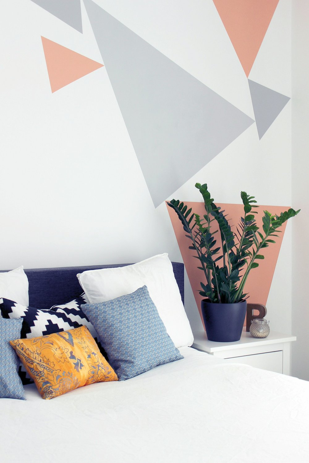 bedroom-white-colourful-cushions-plant