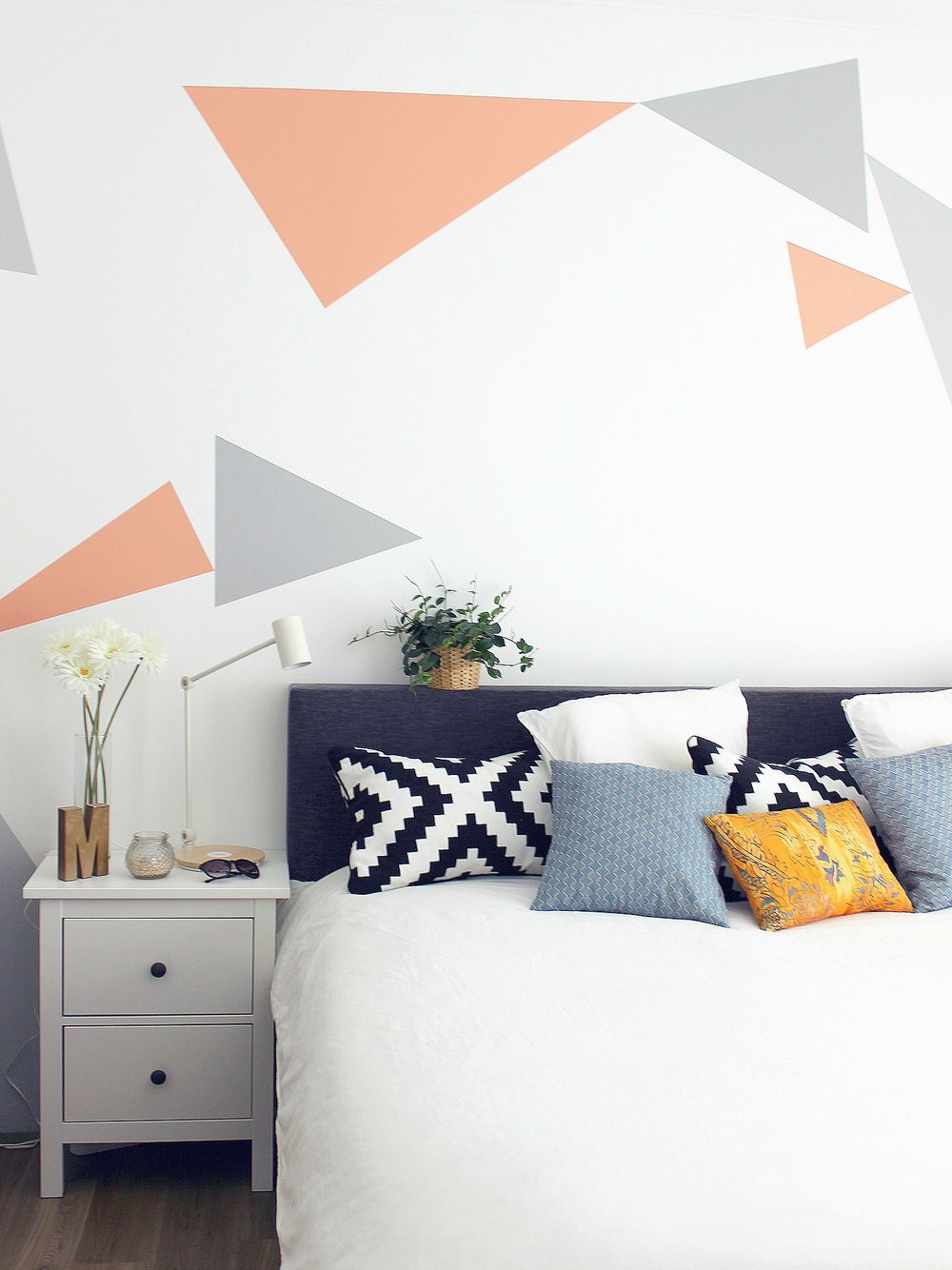 bedroom-white-colourful-cushions-plant-ikea-white-hemnes-drawer-chest