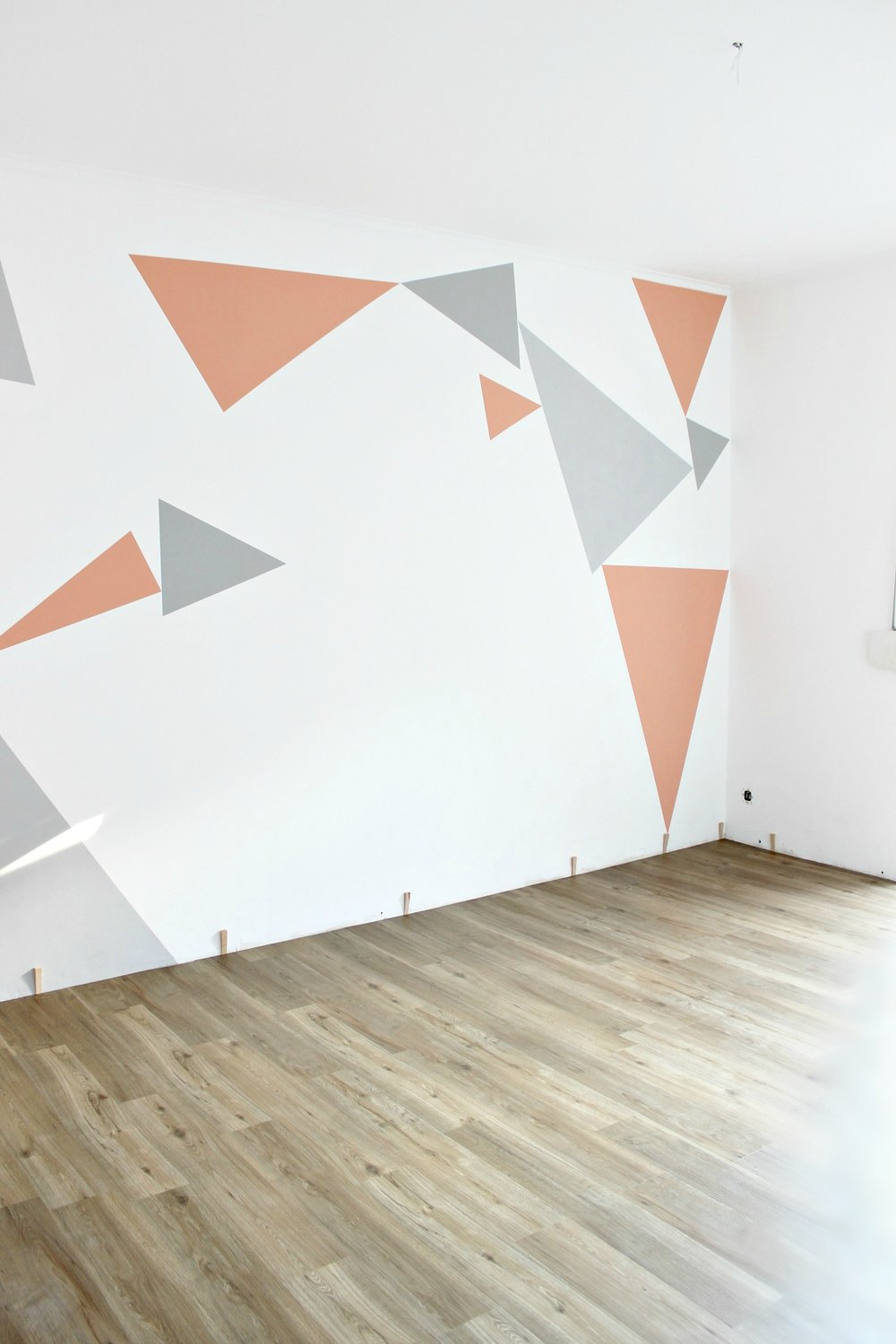 bedroom-statement-wall-triangles-white-walls3.jpg
