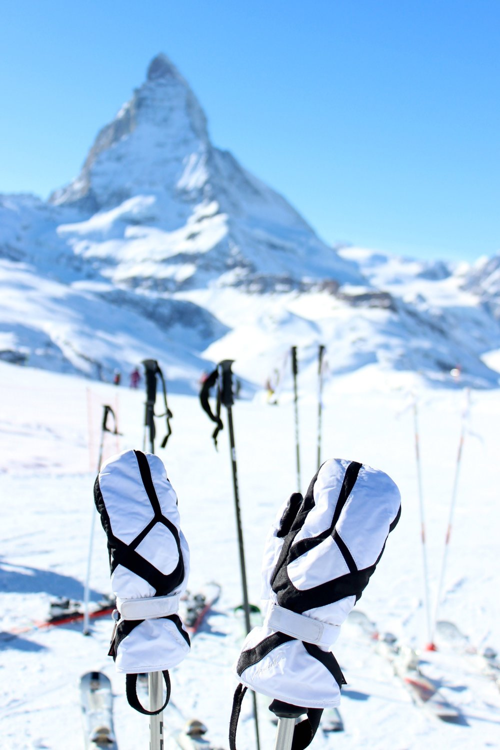 snow-matterhorn-ski-blue-sky-gloves-on-sticks-black-white.jpg