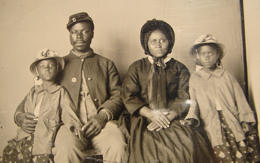 Unidentified African American soldier in Union uniform with wife and two daughters.  Courtesy: Library of Congress