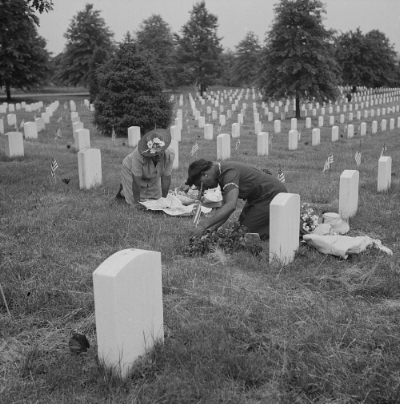 Arlington Cemetery, May 1943. Decorating a solider's grave in one ofthe Negro sections. Library of Congress