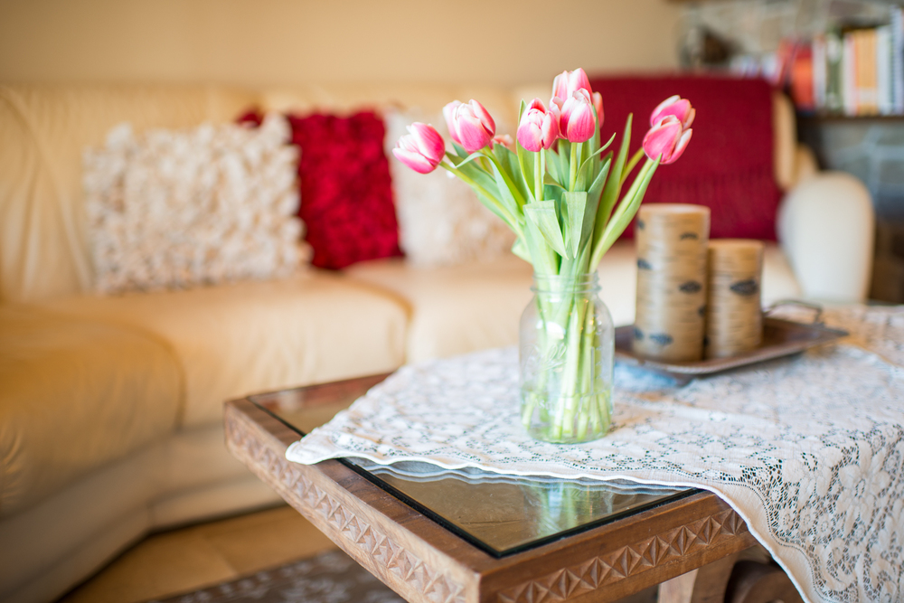 flowers on table in front of a couch