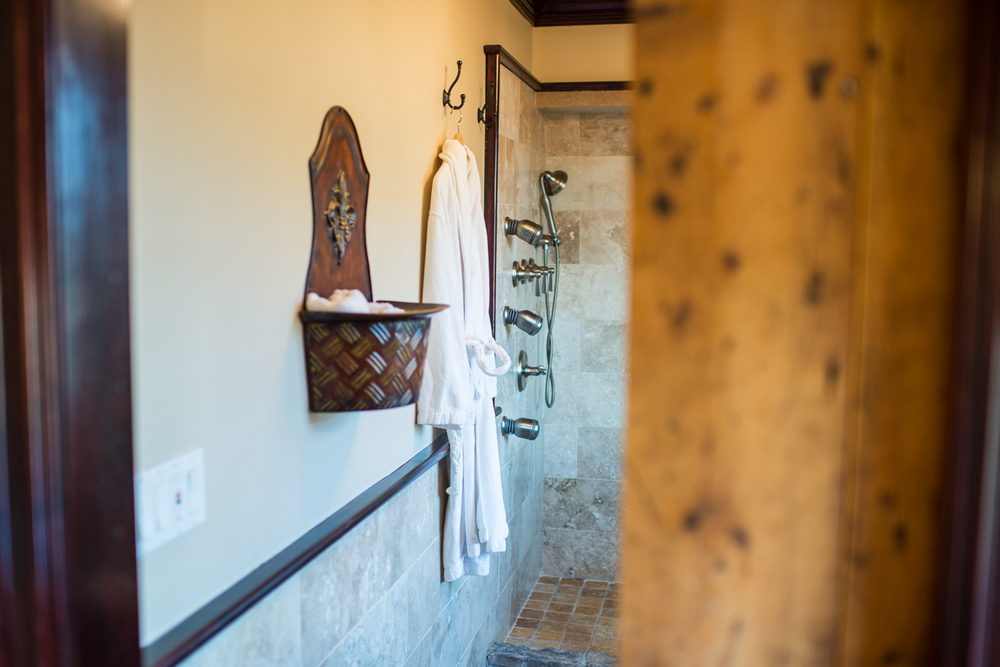 wide shot of bathroom with rope on wall
