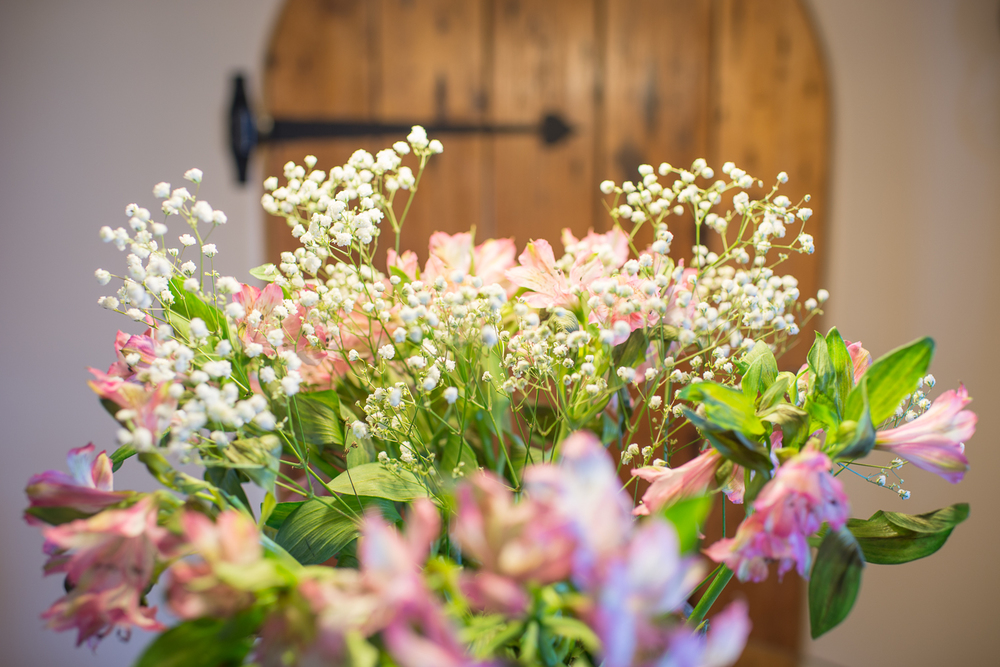 close up of flowers in front of barn door