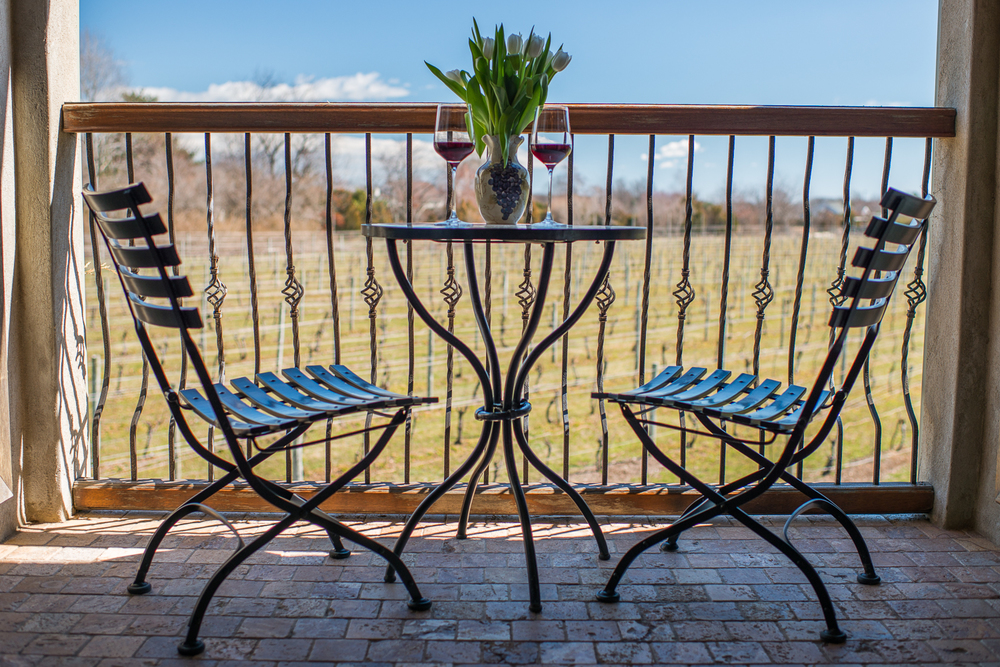 patio with table and chairs with wine glass's on table
