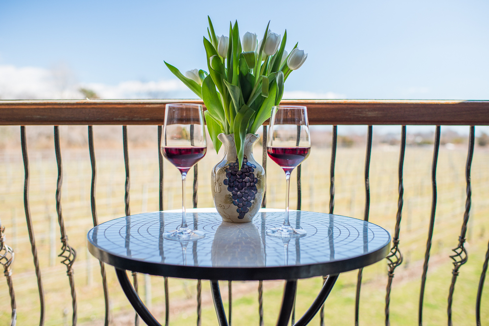 patio table with wine glass's on table