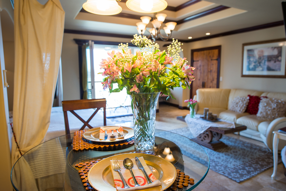 wide image of sitting room with flowers on a table