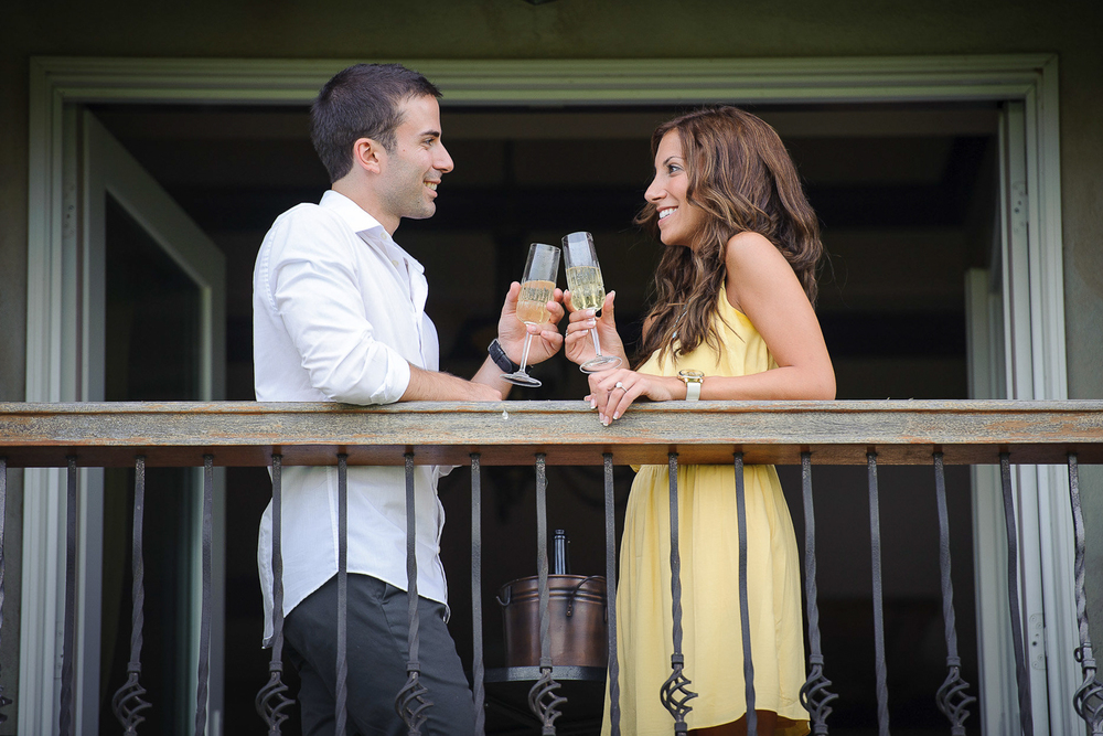 couple enjoying a glass of wine on balcony