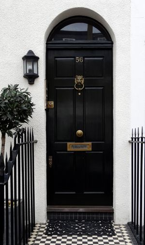 arched black door