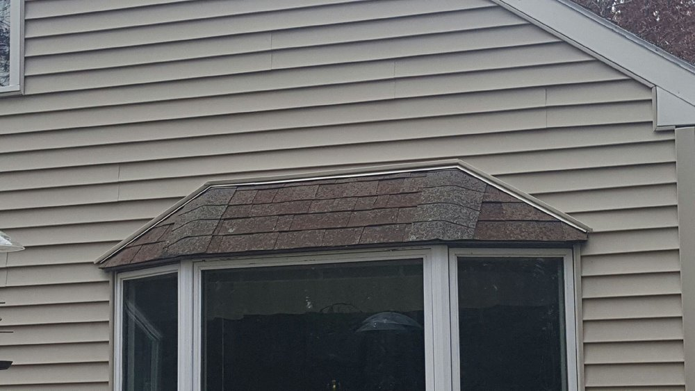 Black Metal Roof in Nashua - Before