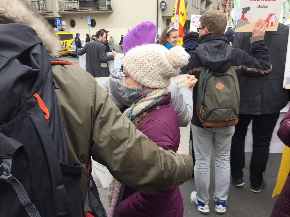 A father's arm around international climate activist, Greta Thunberg. (Photo: Lowell Bliss)