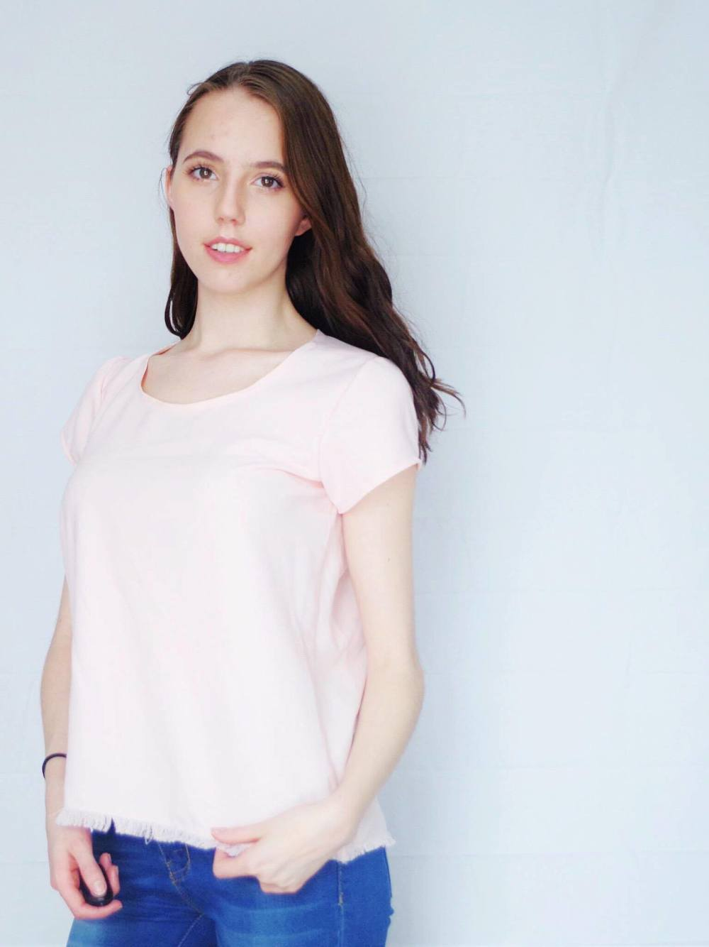 This pretty blush tee has a super-cute raw hem and is EASY to make yourself! Click through for construction details.