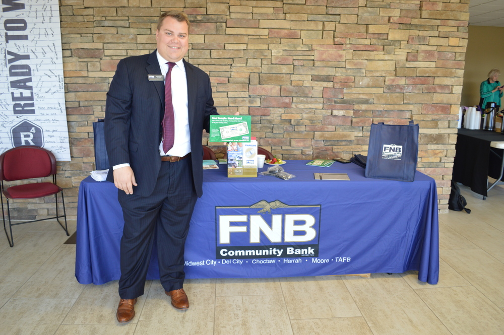 For the second year, FNB Community Bank Vice President Alex Lancaster greets seniors at their booth allowing his co-worker a chance to listen to the speaker. FNB Community Bank has been locally owned and operated since 1943.