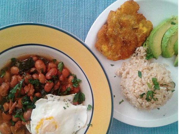 Colombian sytle red beans (using cranberry beans). Typically made in our home vegetarian syle, topped with an egg - and not without home made tostones (Fried green plantain)