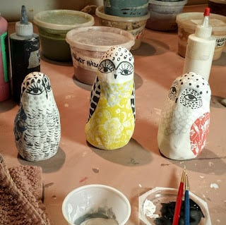 on the table today, painting little owls. Cathy Kiffney