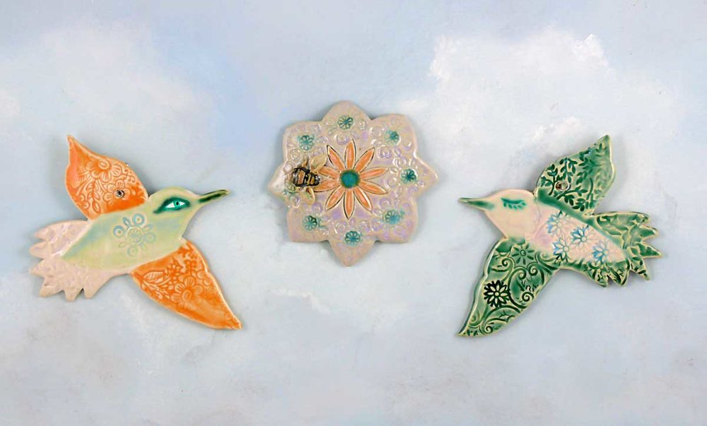 Porcelain hummingbirds and flower medallion. Cathy Kiffney Studio