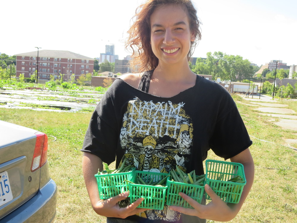 071816_Alyssa with the Harvest of Beans and Peas.JPG