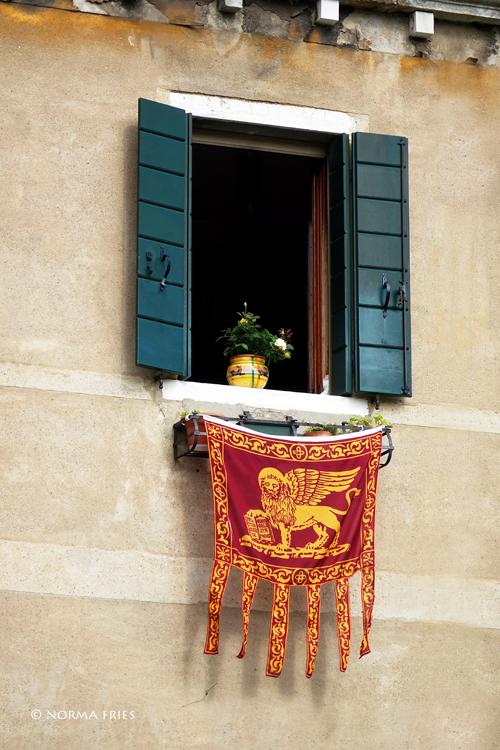 """IT231: Venice: St. Mark's lion flag hangs outside window"""""""