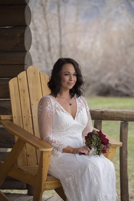 Bride on cabin porch