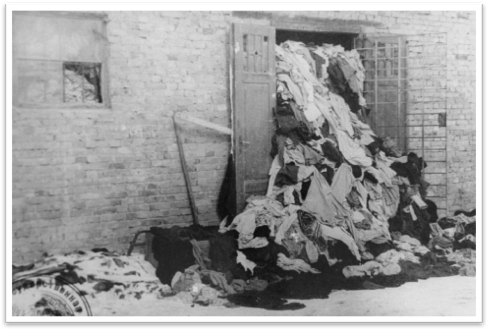 View   of one of the warehouses in Auschwitz,   overflowing   with clothes confiscated from   prisoners, 1945