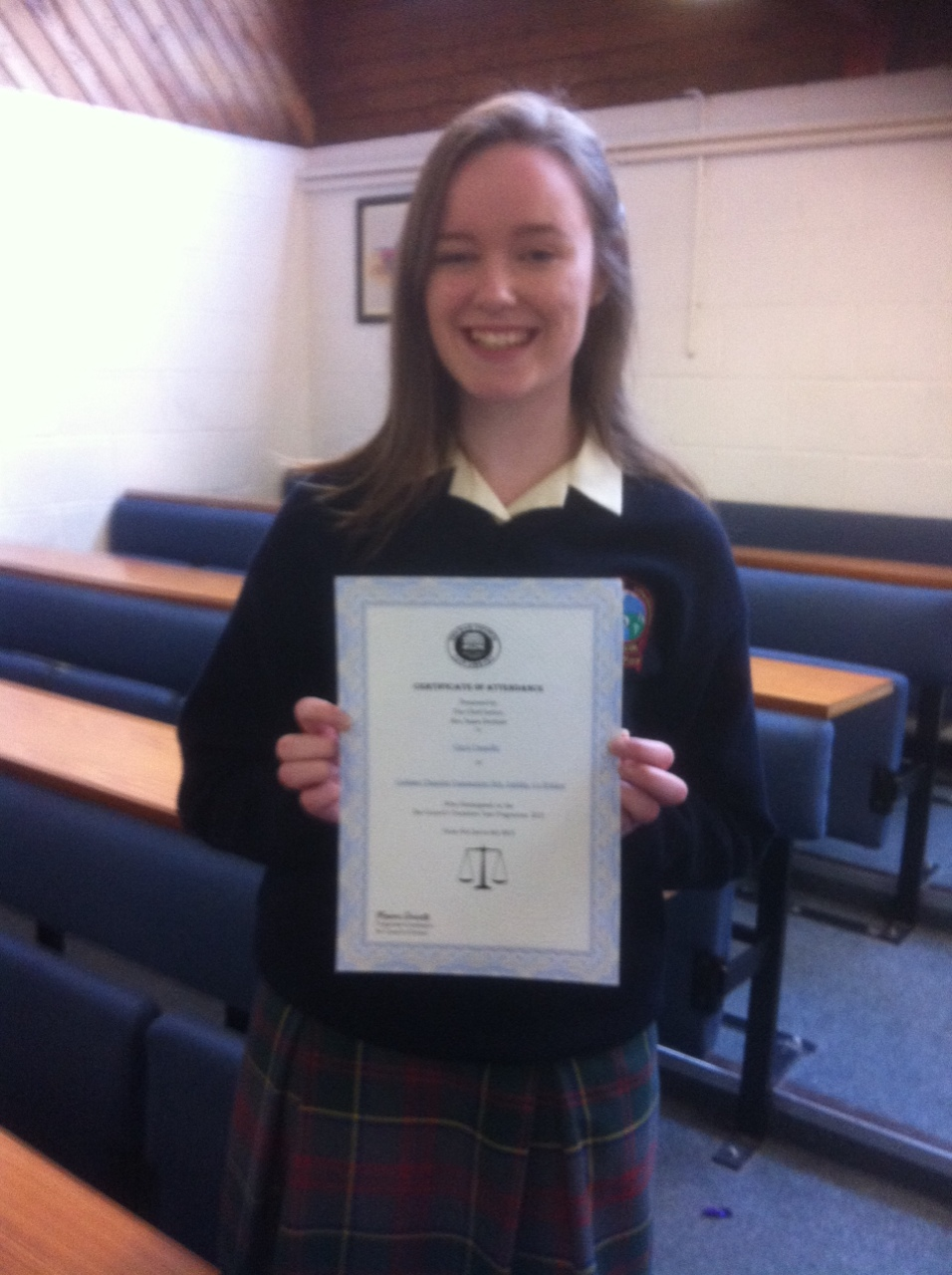 Ciara Cronnolly participated in a week long programme run by the Bar Council. She is pictured holding her certificate signed by Chief Justice Susan Denham.