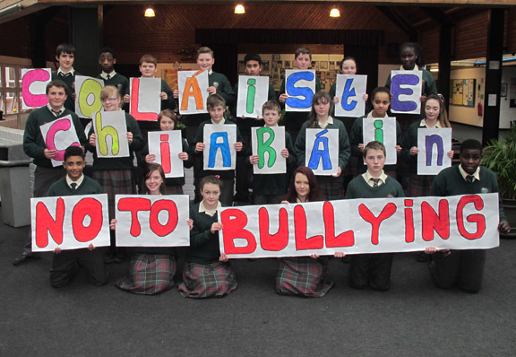 "We are a group second year students who recently undertook a project  on Anti-bullying. We invited 1A3 to help us in promoting an awareness  of this problem. We decided to use our school website to get our  message across and 1A1 felt that it would be best if we could do this  in the physical sense as opposed to verbal.  To this end we designed a poster with each student producing a letter  that goes to spell our message "" Colaiste Chiarain NO to Bullying"". We  then organised the class in the hall and took a  photo. The students  really enjoyed  the experience and we would like to thank them for  their contribution to the project.    Lea Crofton,  Ciara Ferris  Hanna O'Duffy  Jade Brennan  Bronwyn Kenny  and the class of 1A3"