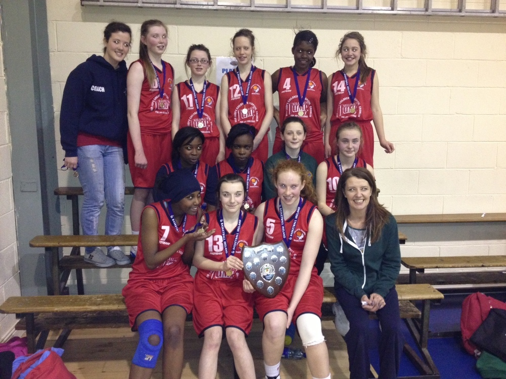 Well done to 1st year girls Basketball team who won the Eastern Region Final in Inchicore yesterday. Included in the photo are:Erin Bracken(assistant coach)Niamh Masterson,Kate O'Toole,Susan Walsh,Berise Habimana,Aoibheann O'Gorman,Bukky Ogundele,Omena Ighovojah,Helen Kelly,Ellen Coburn,Mulky Sharif,Mariah Stewart,Sorcha Tiernan,Yvonne Bracken (coach)  The final score was 57-28. The girls will now go on to all Ireland qualifying tournament after Easter,this will be played Saturday 20th of April in the University of Limerick Arena.
