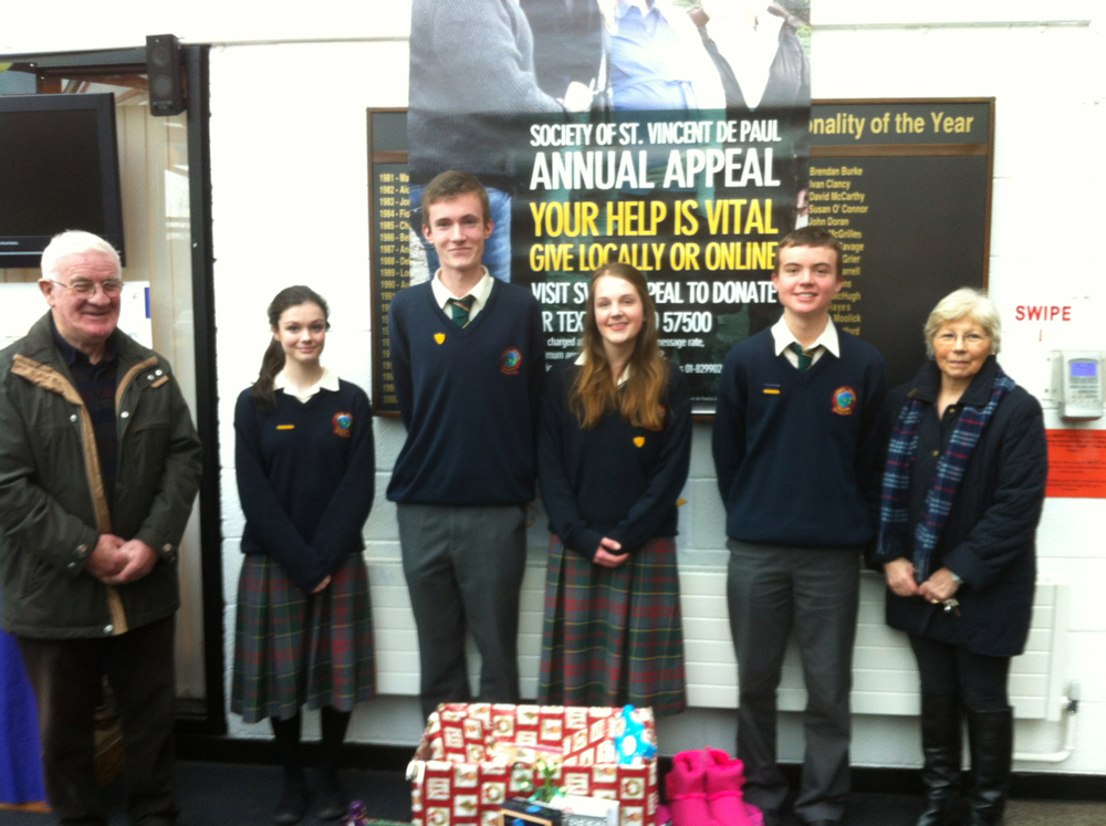 Yvonne and Leo from the Leixlip branch of SVDP receive gifts from 6th Year students on Friday 21st Dec