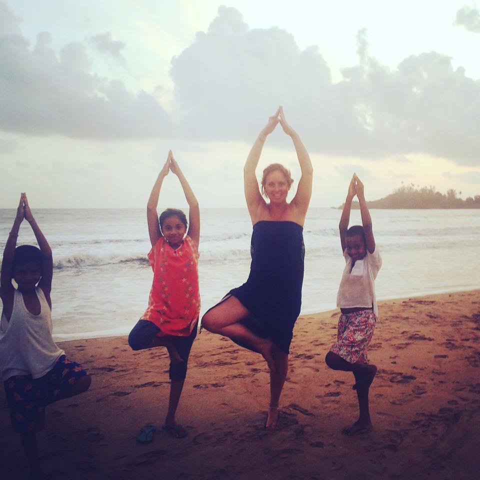 YOGADOO founder, Lucy Aston teaching children on Patnem beach in Goa
