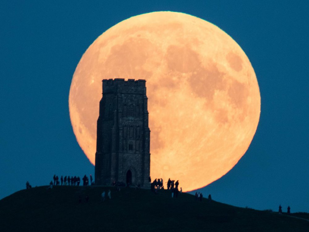 The supermoon rises behind Glastonbury Tor in Somerset,